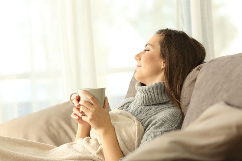 Happy Woman on a Couch